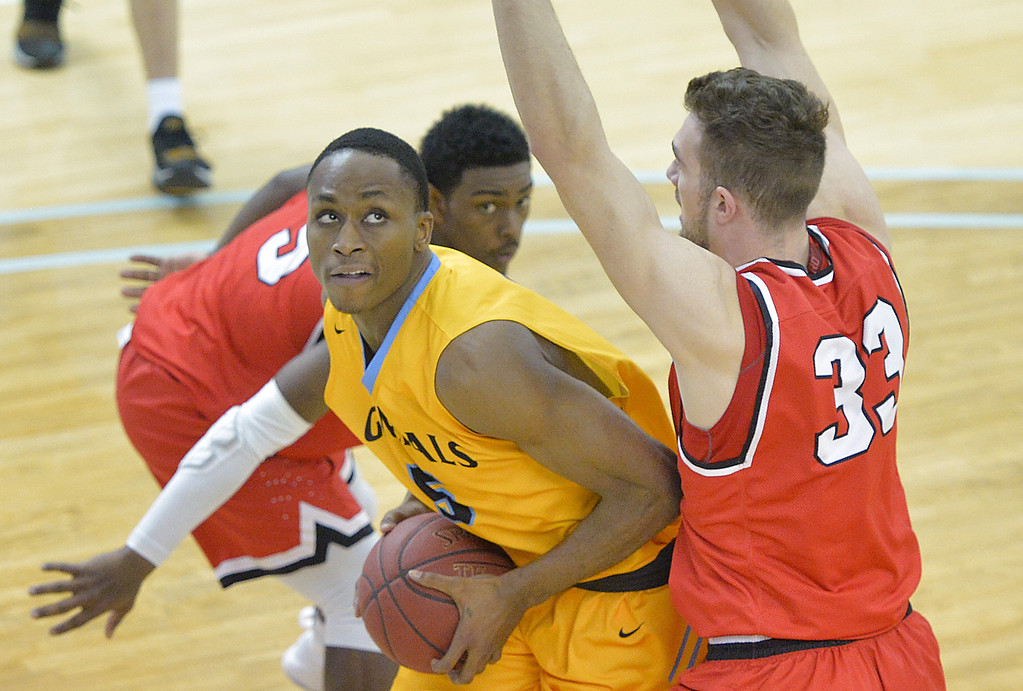 Justin Sheely | The Sheridan Press<br /> Sheridan's Camron Reece battles against Casper College's Antun Maricevic (33) at the Bruce Hoffman Golden Dome Saturday, Jan. 27, 2018. The Generals won 66-62.