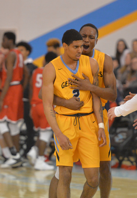 Justin Sheely | The Sheridan Press<br /> Sheridan College's Camron Reece, right, celebrates with AJ Bramah as Casper College calls a timeout at the Bruce Hoffman Golden Dome Saturday, Jan. 27, 2018. The Generals won 66-62.