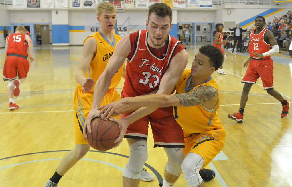 Justin Sheely | The Sheridan Press<br /> Sheridan College's Cody Baumstarck, left, and Sean Sutherlin, right, battle Casper College's Antun Maricevic for the ball at the Bruce Hoffman Golden Dome Saturday, Jan. 27, 2018. The Generals won 66-62.