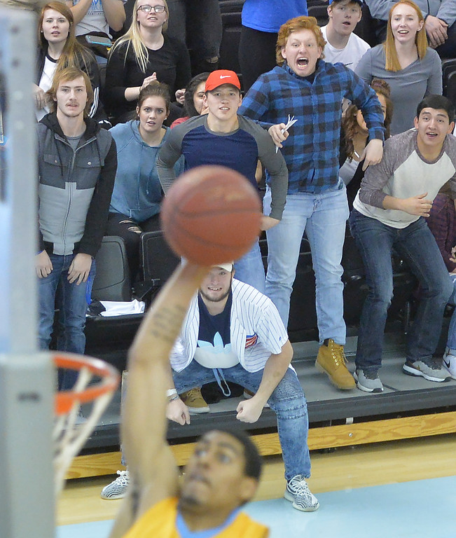 Justin Sheely | The Sheridan Press<br /> Sheridan College students look on as AJ Bramah throws down one against Casper College at the Bruce Hoffman Golden Dome Saturday, Jan. 27, 2018. The Generals won 66-62.