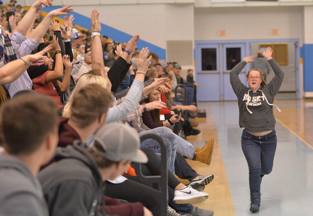 Justin Sheely | The Sheridan Press<br /> Anna Roach creates a wave in the student section at the Bruce Hoffman Golden Dome Saturday, Jan. 27, 2018. The Generals won 66-62.