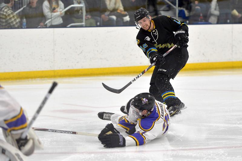 Joel Moline   The Sheridan Press<br /> Sheridan NA3HL Hawks player Steven Delikat (22) has his shot blocked against the Gillette Wild Tuesday, Dec. 31, 2019.