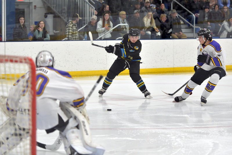 Joel Moline   The Sheridan Press<br /> Sheridan NA3HL Hawks player Jonathan Teasdale (13) takes a shot on goal against the Gillette Wild Tuesday, Dec. 31, 2019.