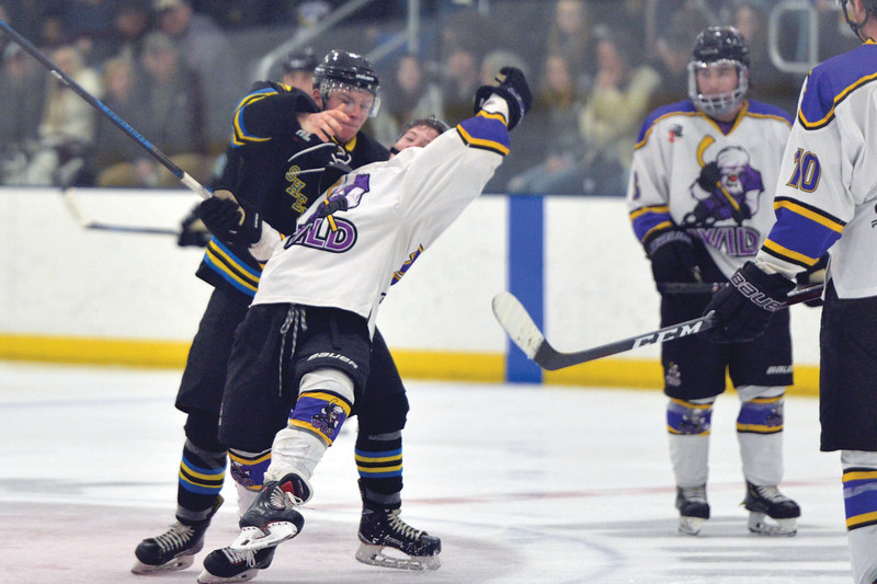 Joel Moline   The Sheridan Press<br /> Sheridan NA3HL Hawks player Anthony Fortin throws a Gillette player to the ice to gain momentum for the team against the Gillette Wild Tuesday, Dec. 31, 2019.