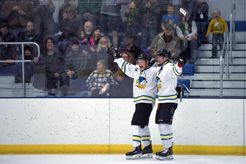 Joel Moline | The Sheridan Press<br /> Sheridan NA3HL Hawks players Justin Schawrtzmiller (11), left and Stepan Ruta (24) celebrate after Schartmills's second goal of the game against the Missoula Junior Bruins Saturday, Nov. 9, 2019.