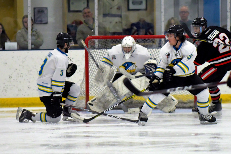 Joel Moline | The Sheridan Press<br /> Sheridan NA3HL Hawks players Sandis Cook (3) and Jonathan Bruno (5) try to block the puck before it reaches goalie James Downie (31) against the Missoula Junior Bruins Saturday, Nov. 9.