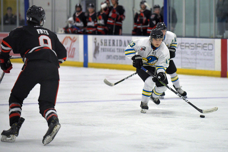 Joel Moline | The Sheridan Press<br /> Sheridan NA3HL Hawks player Jonathan Teasdale (13) takes control of the puck in the offensive zone against the Missoula Junior Bruins Saturday, Nov. 9.