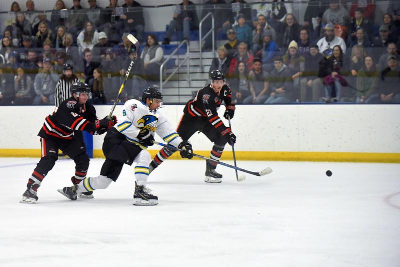 Joel Moline | The Sheridan Press<br /> Sheridan NA3HL Hawks player Trevor Timm (9) rips a shot towards goal with the defense right behind him against the Missoula Junior Bruins Saturday, Nov. 9, 2019.