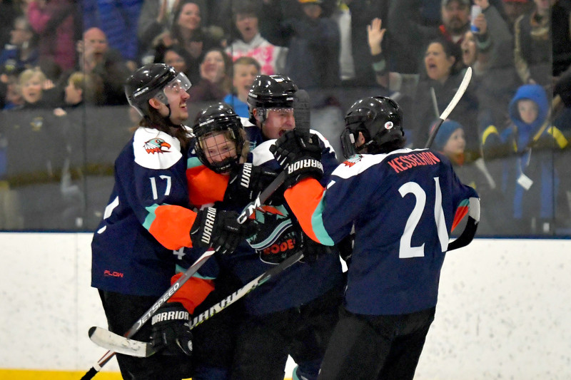 Joel Moline | The Sheridan Press<br /> Sheridan NA3HL Hawks player Blake Billings (14) is mobbed by teammates after tieing the game against the Yellowstone Quake Saturday, Feb. 22, 2020.
