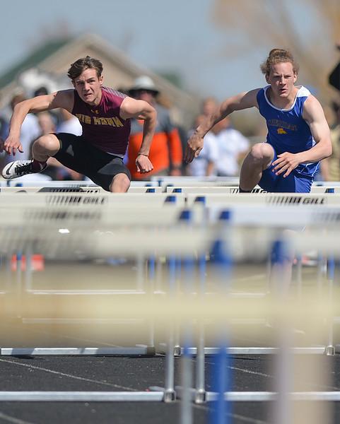 Justin Sheely | The Sheridan Press<br /> Big Horn's Liam Greenelsh, left, races Sheridan's Alex Riegert in the 100-meter hurdles during the Dan Hansen invite at Sheridan High School Saturday, April 21, 2018.