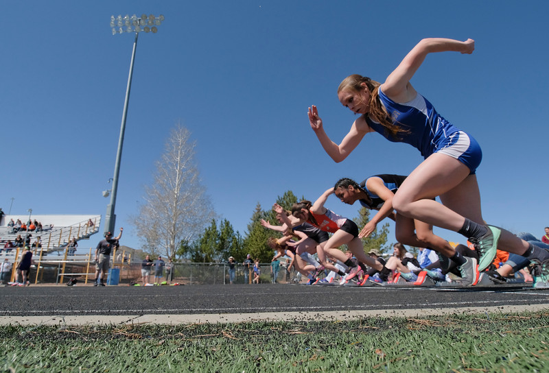 Justin Sheely | The Sheridan Press<br /> Sheridan's Samara Ordahl, right, starts for the 100-meter sprint during the Dan Hansen invite Sheridan High School Saturday, April 21, 2018.
