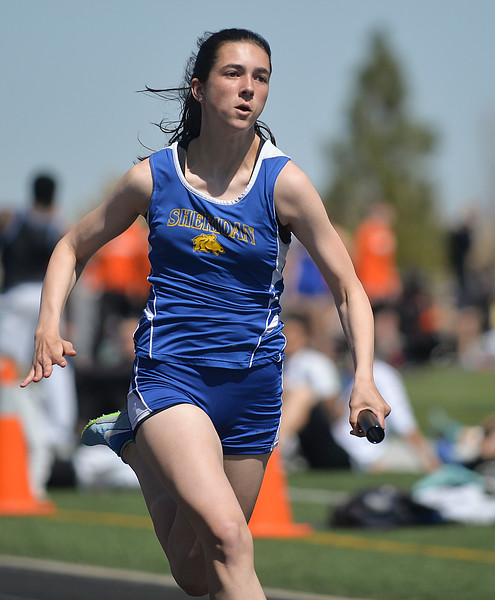 Justin Sheely | The Sheridan Press<br /> Sheridan's Piper O'Dell finishes the 4x100 relay for first place during the Dan Hansen invite Sheridan High School Saturday, April 21, 2018.
