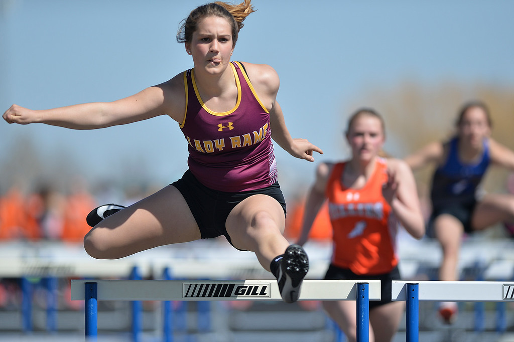 Justin Sheely | The Sheridan Press<br /> Big Horn's Madison Butler competes in the 100-meter hurdles during the Dan Hansen invite at Sheridan High School Saturday, April 21, 2018.