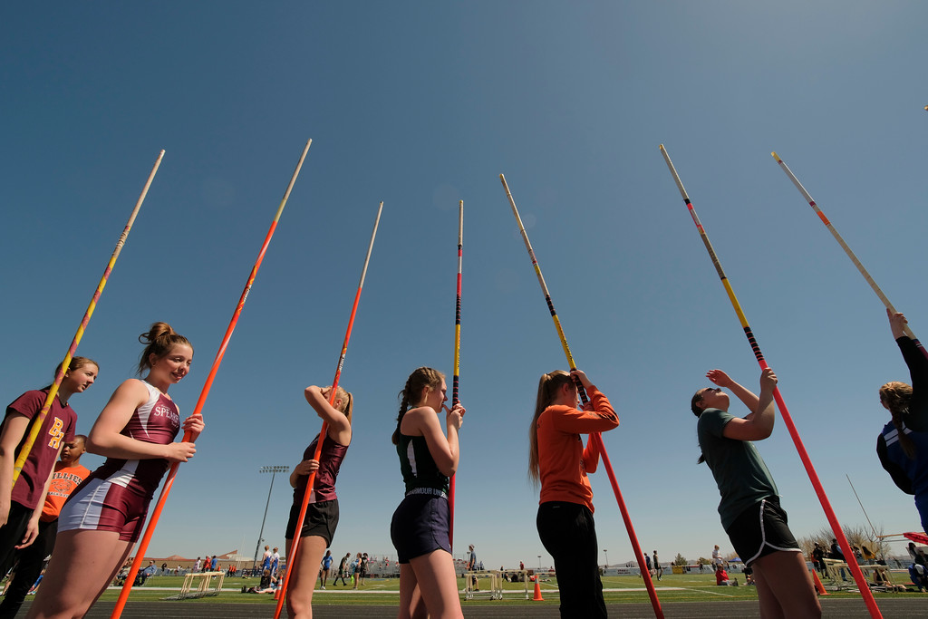 Justin Sheely | The Sheridan Press<br /> Girls line up to practice pole vault during the Dan Hansen invite Sheridan High School Saturday, April 21, 2018.