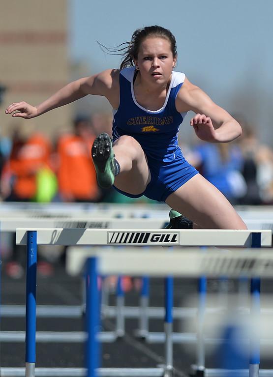 Justin Sheely | The Sheridan Press<br /> Sheridan's Samara Ordahl competes in hurdles during the Dan Hansen invite at Sheridan High School Saturday, April 21, 2018.