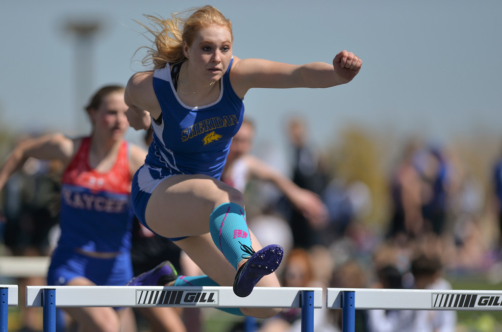Justin Sheely | The Sheridan Press<br /> Sheridan's Amber Grutzmacher competes in the 100-meter hurdles during the Dan Hansen invite at Sheridan High School Saturday, April 21, 2018.