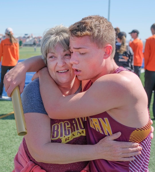 Justin Sheely | The Sheridan Press<br /> Big Horn's Nathaniel Lydic is congratulated by Niane Marney after the boys qualify in the 4x800 during the Dan Hansen invite at Sheridan High School Saturday, April 21, 2018.