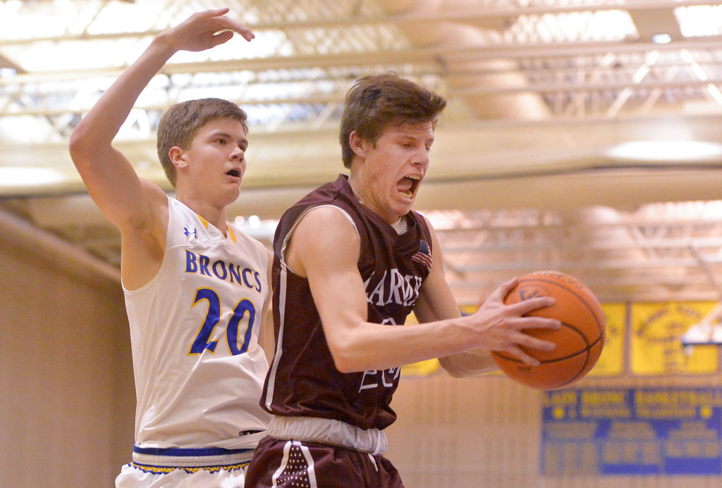 Justin Sheely | The Sheridan Press<br /> <br /> Sheridan's Gus Wright, left, and Laramie High School's Elliot Boley rebound at Sheridan High School Friday, Jan. 19, 2018. The Broncs cruised past the Plainsmen 71-36.