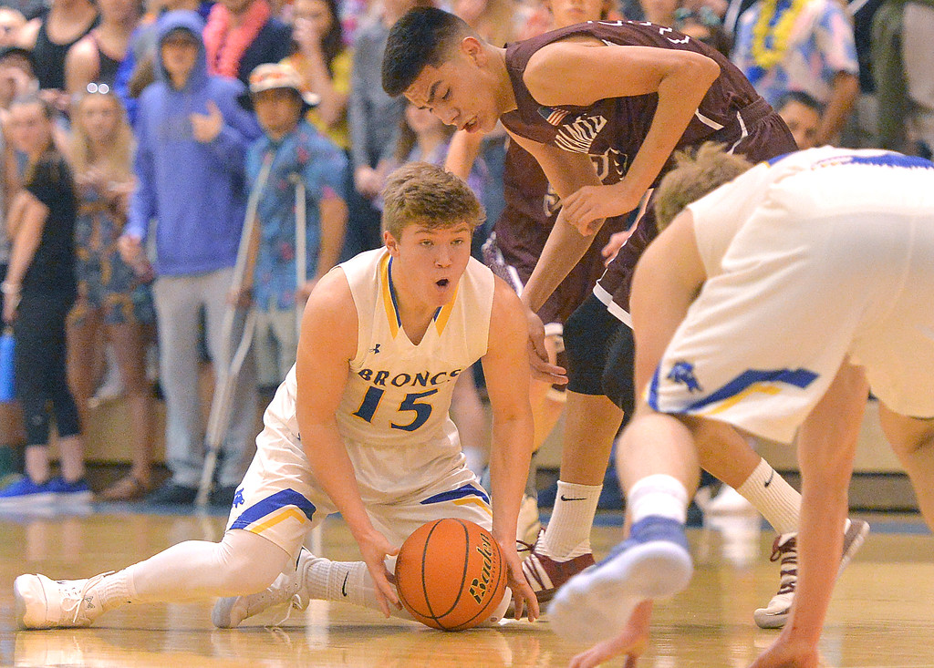 Justin Sheely | The Sheridan Press<br /> <br /> Sheridan's Tristan Bower, left, strips the ball from Laramie High School's Hudda Herrera at Sheridan High School Friday, Jan. 19, 2018. The Broncs cruised past the Plainsmen 71-36.