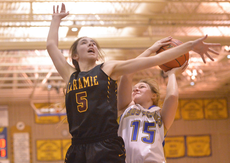 Justin Sheely | The Sheridan Press<br /> <br /> Sheridan's Kaile Ingalls (15) is fouled by Laramie High School's Ariel Bell during their first conference game at Sheridan High School Friday, Jan. 19, 2018. The Lady Broncs won 57-40.