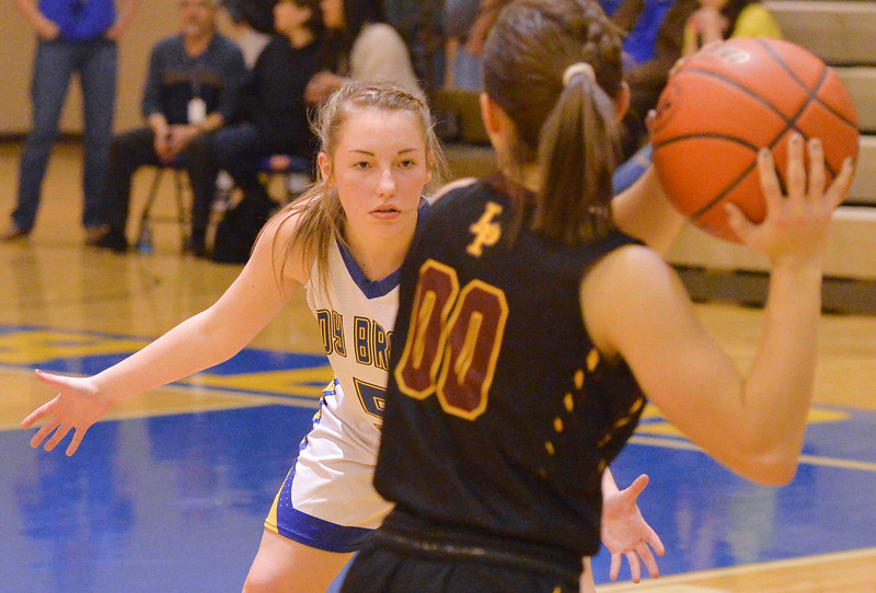 Justin Sheely | The Sheridan Press<br /> <br /> Sheridan's Alli Puuri guards Laramie High School's Sekoya Romero during their first conference game at Sheridan High School Friday, Jan. 19, 2018. The Lady Broncs won 57-40.