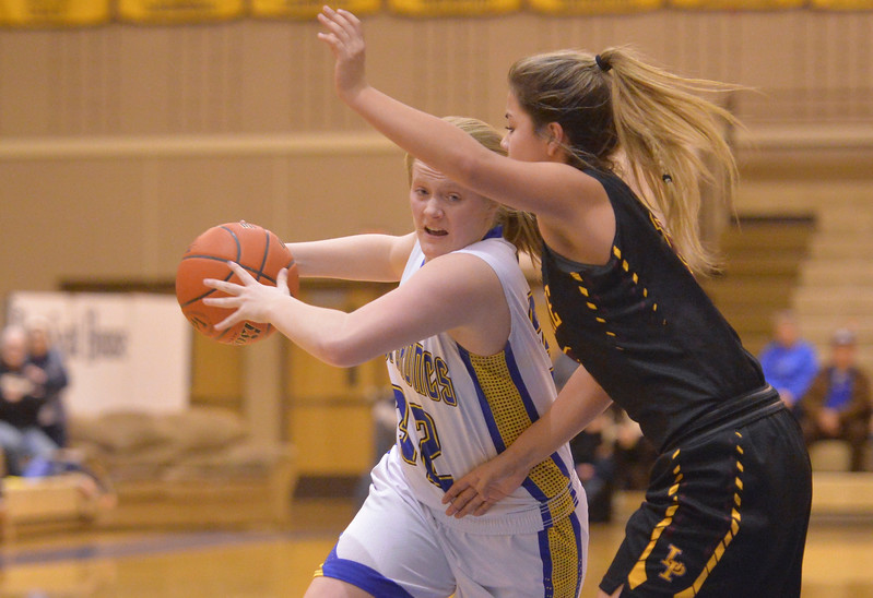 Justin Sheely | The Sheridan Press<br /> <br /> Sheridan's Katie Tomlinson, left, drives against Laramie High School during their first conference game at Sheridan High School Friday, Jan. 19, 2018. The Lady Broncs won 57-40.