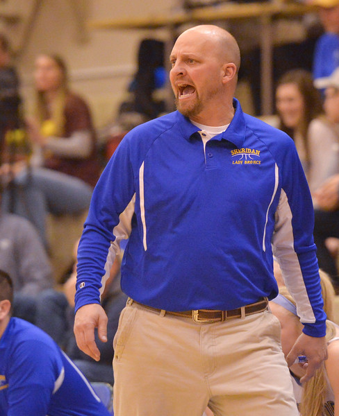 Justin Sheely | The Sheridan Press<br /> <br /> Sheridan's head coach Larry Ligocki shouts during the first conference game at Sheridan High School Friday, Jan. 19, 2018. The Lady Broncs won 57-40.