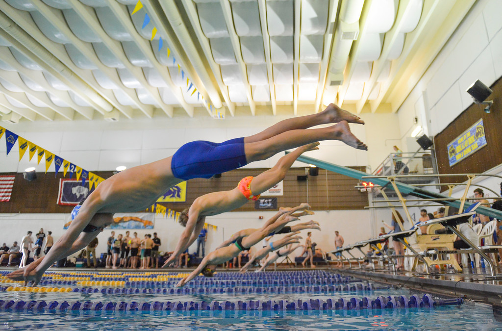 Justin Sheely | The Sheridan Press<br /> Sheridan's Thomas Yates, front, jumps off the block for the final heat of the 100-meter freestyle during the Sheridan invite at the Sheridan Junior High School Pool Saturday, Jan. 6, 2018.