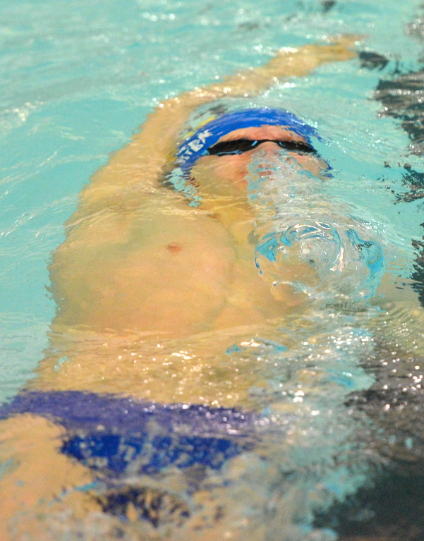 Justin Sheely | The Sheridan Press<br /> Sheridan's Oscar Patten kicks off the wall for a back stroke in the 200-meter IM during the Sheridan invite at the Sheridan Junior High School Pool Saturday, Jan. 6, 2018.