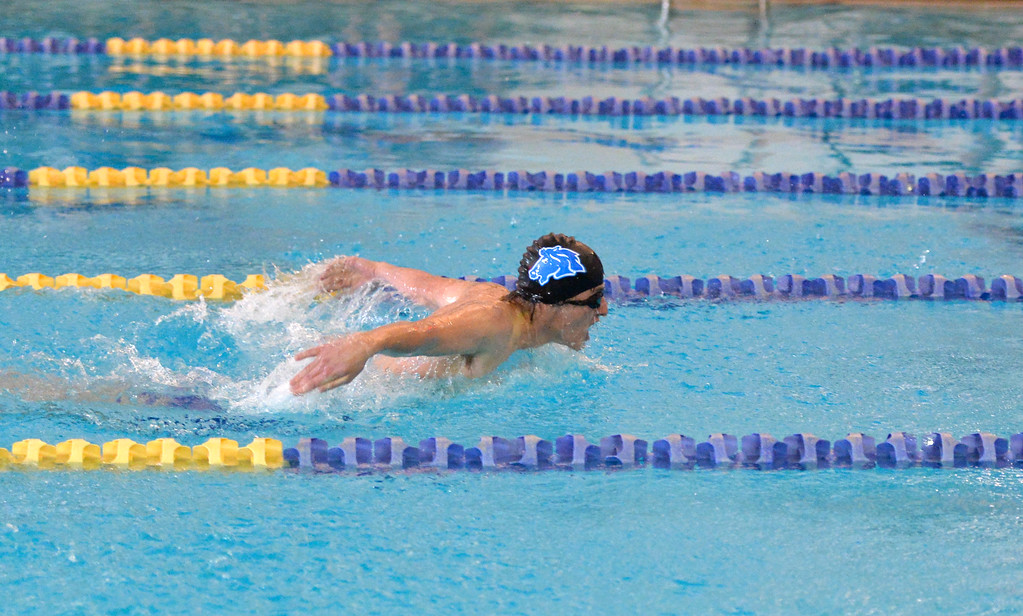 Justin Sheely | The Sheridan Press<br /> Sheridan's Kody Palmer finishes first in the 100-meter butterfly during the Sheridan invite at the Sheridan Junior High School Pool Saturday, Jan. 6, 2018.