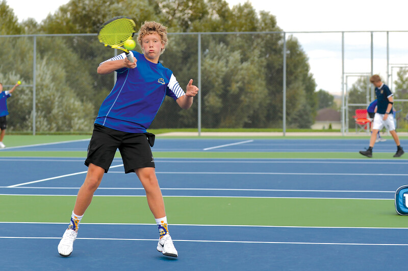 Joel Moline | The Sheridan Press<br /> Sheridan's Reed Rabon returns the ball in a tennis match against Cody High School Tuesday, Sept. 10, 2019.