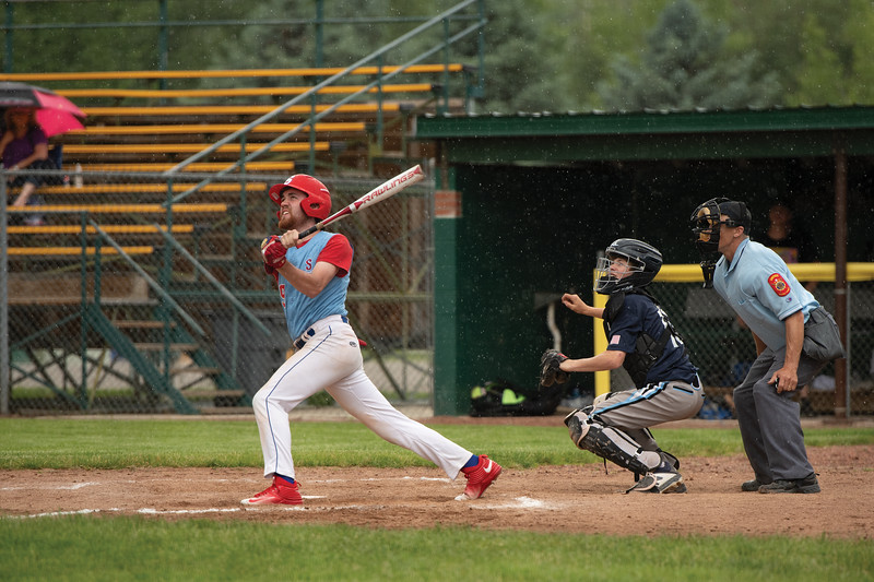 Matthew Gaston   The Sheridan Press<br>Sheridan's Race Johnston (19) drives a hit into left field at Thorne-Rider Stadium Wednesday, June 19, 2019.