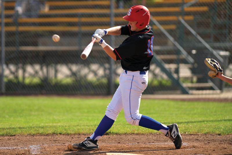 Matthew Gaston | The Sheridan Press<br>Sheridan's Jacob Boint (12) sends a shot deep into right-center field against Billings Friday, July 5, 2019.