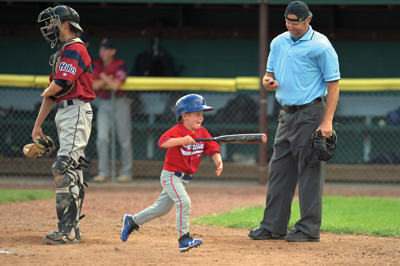 Matthew Gaston | The Sheridan Press<br>Sheridan's batboy Brooks Phillips showed some serious hustle during the Troopers 17-1 schlaking of the Billings Halos Friday, July 5, 2019.