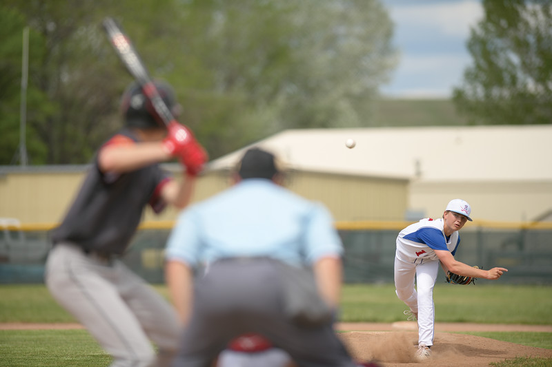 Matthew Gaston | The Sheridan Press<br>The Sheridan Troopers' Trvor Stowe (1) fires off a pitch against Gillette's shortstop Wednesday, May 27, 2020. Gillette defeated Sheridan 12-0.