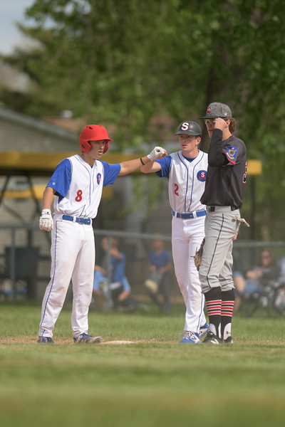 Matthew Gaston | The Sheridan Press<br>Sheridan's Cody Kilpatrick (8) fist bumps Rich Hall after a solid base hit against Gillette Wednesday, May 27, 2020.