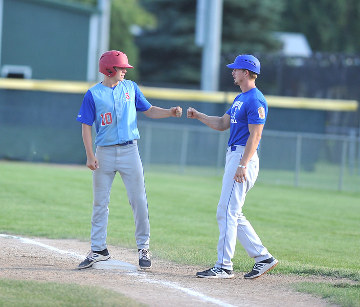 Bud Denega | The Sheridan Press<br /> Sheridan's Quinn McCafferty, left, and older brother Connor talk at first in a game against Gillette at Thorne-Rider Stadium Wednesday, July 18, 2018. The Roughriders topped the Troopers 8-4.
