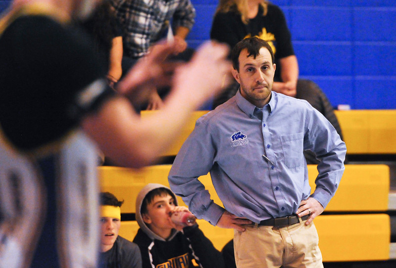 Justin Sheely | The Sheridan Press<br /> <br /> Broncs wrestling head coach looks at Quin Heyneman during his match against Cheyenne East at Sheridan High School Friday, Feb. 2, 2018.