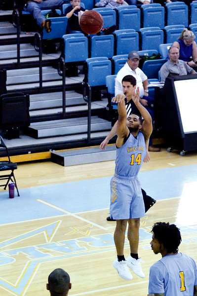 Joel Moline | The Sheridan Press<br /> Sheridan College's Markel Aune (14) makes a 3-pointer against the Sheridan All-Stars, Saturday, Nov. 30.