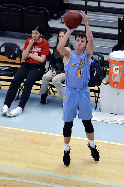 Joel Moline | The Sheridan Press<br /> Sheridan College's Hayden Peterson (0) attempts a 3-pointer against the Sherida All-Stars, Saturday, Nov. 30, 2019.