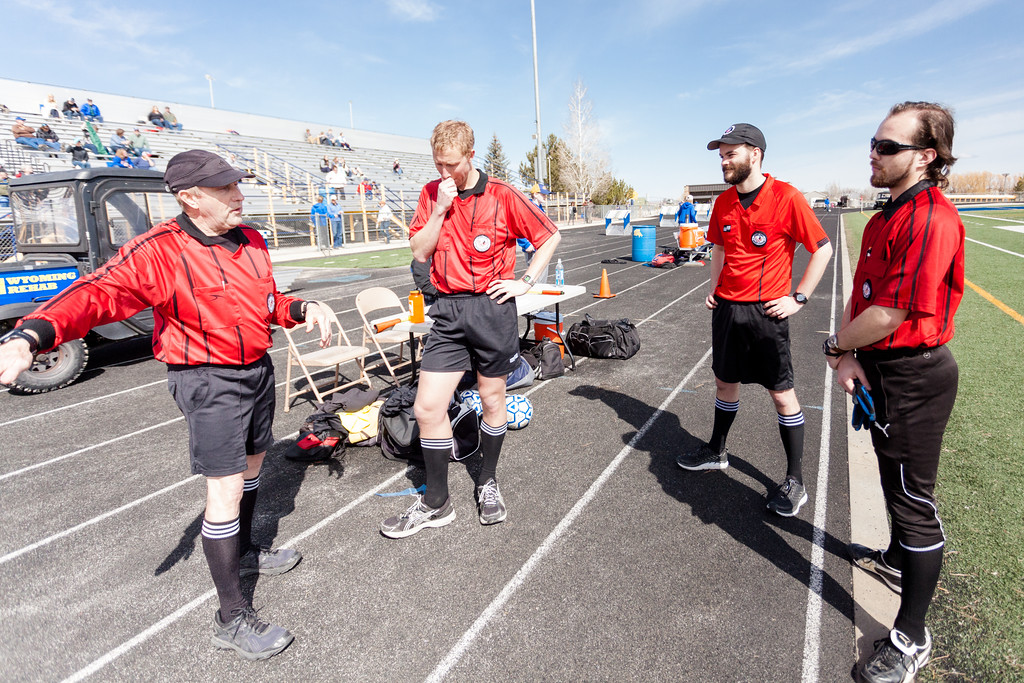 Tibby McDowell   The Sheridan Press  <br /> Referee's, from left, Dennis West, Patrick Geary, Ben McDaniel, and Josiah Maixner have a meeting about hand signals during half-time of the girls varsity soccer game against Gillette at Homer Scott Field Saturday, April 14, 2018.