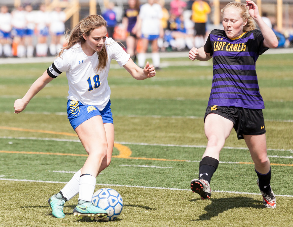 Tibby McDowell   The Sheridan Press  <br /> Cassidy Schellinger keeps control over the ball against Gillette's Emma Jarvis during girls varsity soccer at Homer Scott Field Saturday, April 14, 2018.