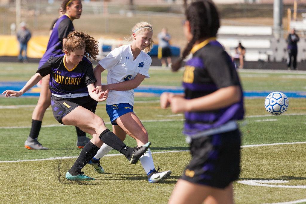 Tibby McDowell   The Sheridan Press  <br /> Kaylee Abernatha, right, collides with Gillette's Kennedy Schomer during girls varsity soccer at Homer Scott Field Saturday, April 14, 2018.