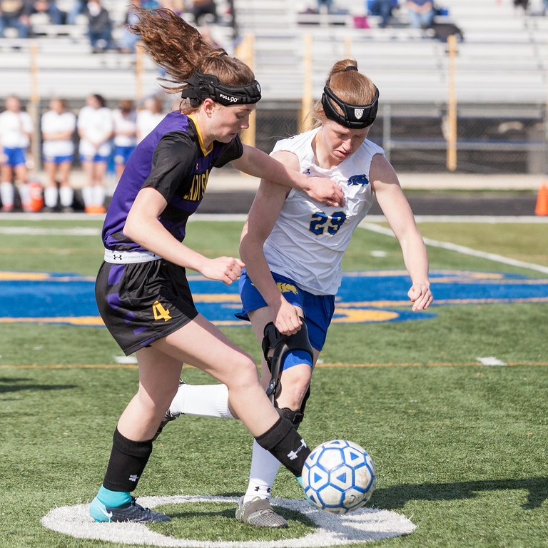 Tibby McDowell   The Sheridan Press  <br /> Mikayla Johnson, right, battles with Gillette's Shaelea Milliron during the first half of girls varsity soccer at Homer Scott Field Saturday, April 14, 2018.