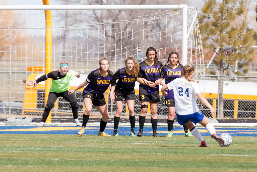 Tibby McDowell   The Sheridan Press  <br /> Aria Heyneman (24) takes a penalty shot on goal during girls varsity soccer at Homer Scott Field Saturday, April 14, 2018.  The Sheridan Lady Broncs couldn't break through the Lady Camels defense and went down with a score of 0-1.