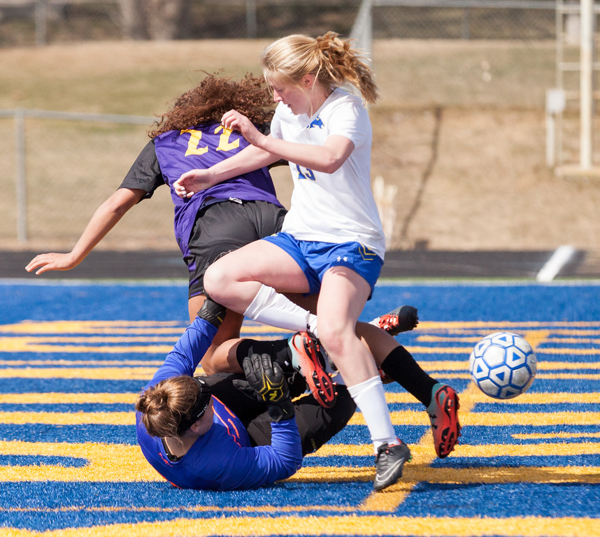 Tibby McDowell   The Sheridan Press  <br /> Sheridan keeper Zoie Jones gets trampled by Gillette's McKenzee Nuzum and Sheridan's Bridgette Maxey as they follow the ball into the goal area during girls varsity soccer at Homer Scott Field Saturday, April 14, 2018.