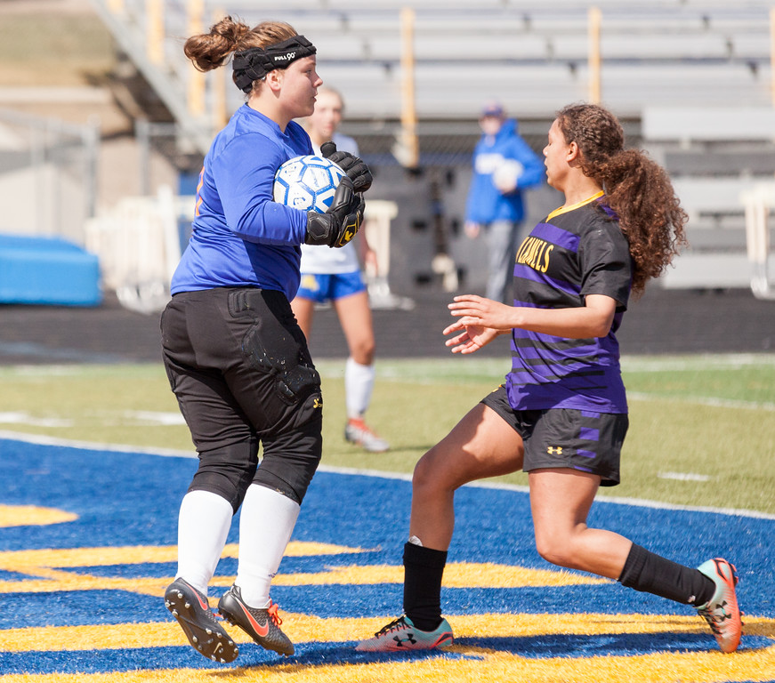 Tibby McDowell   The Sheridan Press  <br /> Sheridan keeper Zoie Jones blocks a shot on goal during girls varsity soccer at Homer Scott Field Saturday, April 14, 2018.