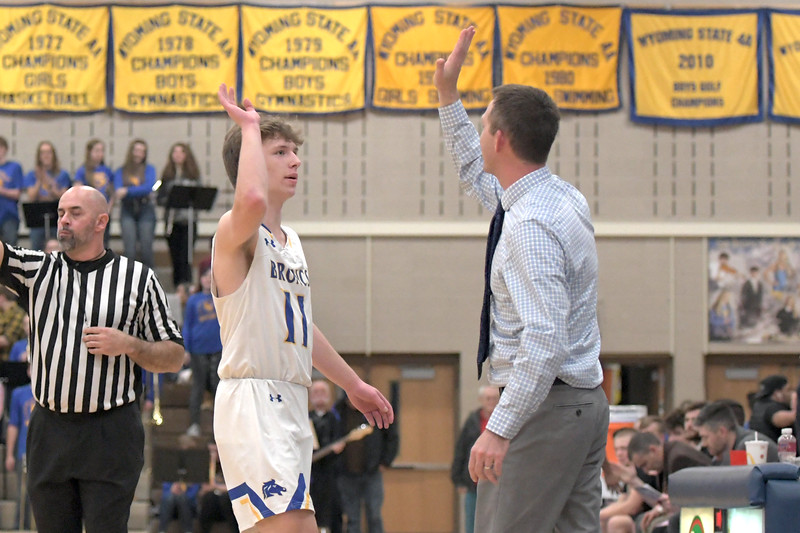 Joel Moline | The Sheridan Press<br /> Sheridan's Ethan Rickett (11) receives a high-five from head coach Jeff Martini as he leaves the home court for the final time against Campbell County High School Friday, Feb. 21, 2020.