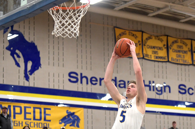 Joel Moline | The Sheridan Press<br /> Sheridan's Gus Wright (5) attempts a layup against Campbell County High School Friday, Feb. 21, 2020.