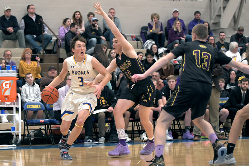 Joel Moline | The Sheridan Press<br /> Sheridan's Zach Koltiska (3) drives baseline against Campbell County High School Friday, Feb. 21, 2020.